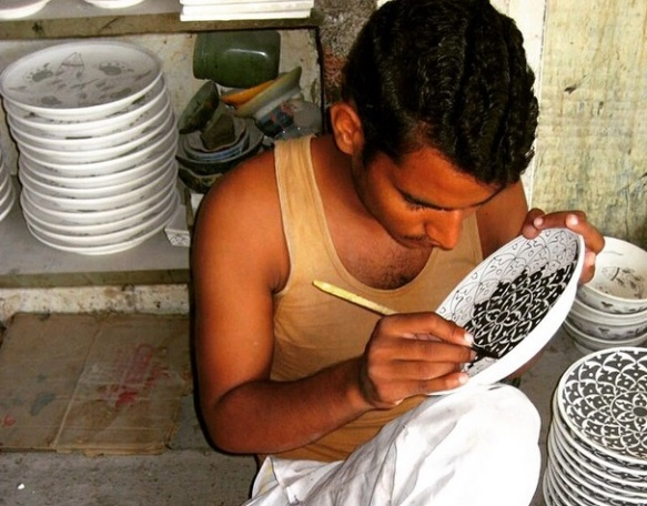 Artisan Soaib Saeed hand paints all the intricate designs
