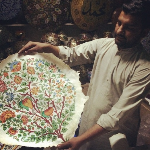 Mohammad Hassan showing one of his works